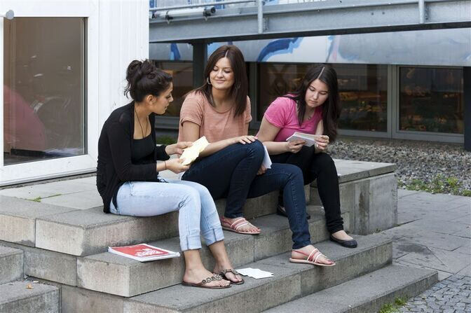 Students sitting on library steps